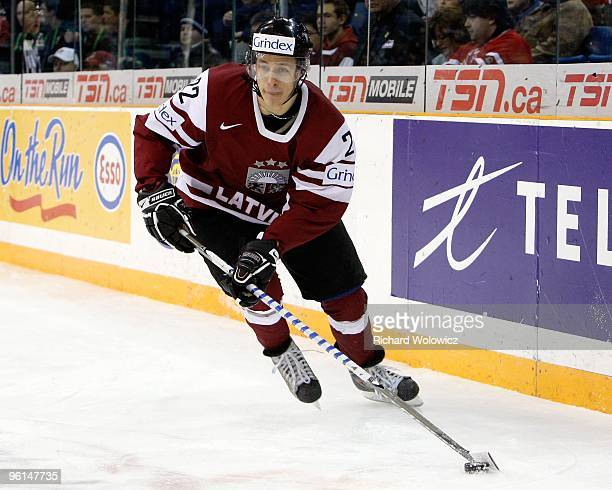 Rolands Vigners of Team Latvia skates with the puck during the 2010 IIHF World Junior Championship Tournament Relegation game against Team Austria on...