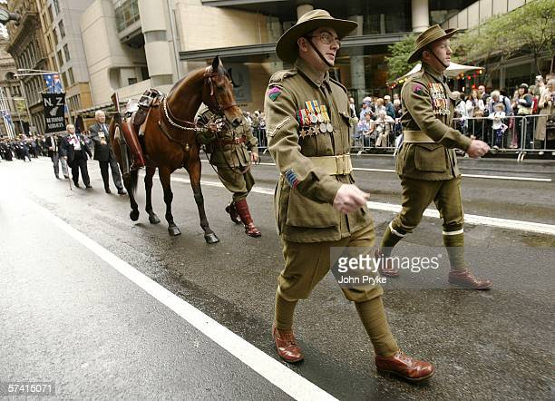 Role players dressed in World War One era uniforms lead a riderless horse signifying lost comrades march during the Anzac Day parade April 25 2006 in...