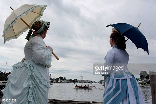 Role players l to r Karlee Etter and Amanda Nichols watching the Whaleboat parade during the relaunch of Mystic Seaport Museum's flagship whaling...