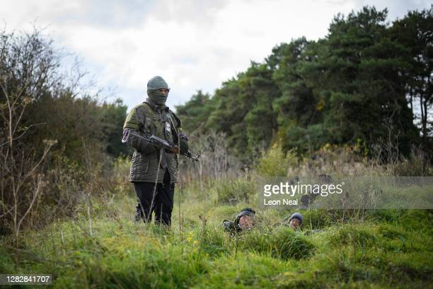 Role-play actors prepare to take part in an ambush during a Mission Rehearsal Exercise ahead of the UK Task Group deployment to Mali, on the Ministry...