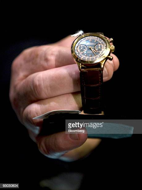 A Rolex 18carat gold chronograph model 3525 prisoner watch is displayed during a media preview for an auction which includes jewelry and other...