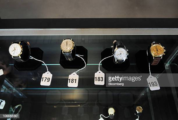 Rolex and Patek Philippe watches are displayed with other furnishings during a media preview of the auction of personal property that once belonged...