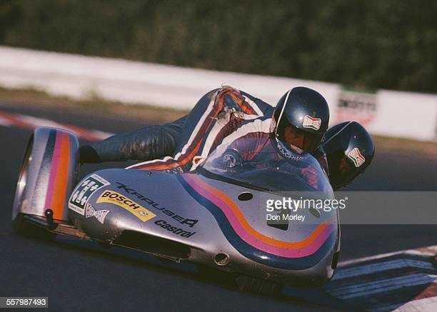 Rolf Biland of Switzerland and his sidecar passenger Kenneth Williams rides the BEO/Yamaha combination during the German motorcycle sidecar 500cc...