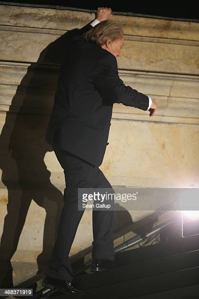 Rolf Eden makes his was up the main stairs outside as he arrives for the Cinema For Peace 2014 Gala at Konzerthaus Am Gendarmenmarkt on February 10...