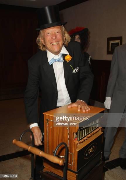 Rolf Eden plays a barrel organ at the 111 Berlin Press ball at Maritim Hotel on January 9 2010 in Berlin Germany