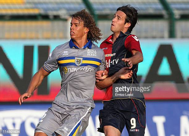 Rolf Feltscher of Parma FC and Robert Acquafresca of Cagliari Calcio in action during the Serie A match between Cagliari Calcio and Parma FC at...