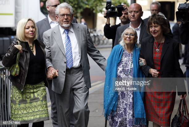 Rolf Harris arrives at Southwark Crown Court accompanied by daughter Bindi wife Alwen and niece Jenny on June 26 2014 in London England