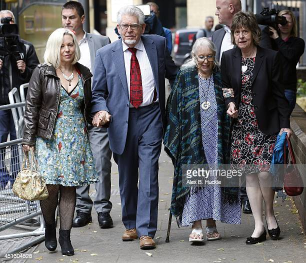 Rolf Harris arrives at Southwark Crown Court accompanied by daughter Bindi Harris wife Alwen Hughes and niece Jenny on June 27 2014 in London England