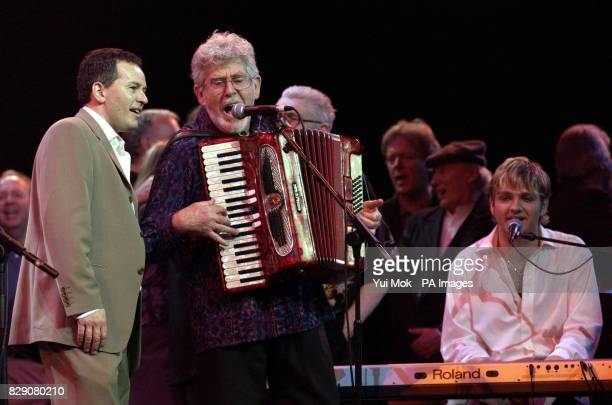 Rolf Harris performing with Lonnie Donegan's two sons Peter and Anthony during the Lonnie Donegan tribute concert at the Royal Albert Hall in central...