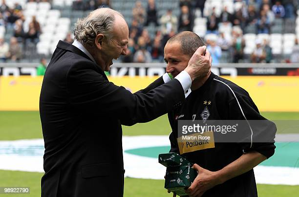 Rolf Koenigs , president of Gladbach hands over a present to Oliver Neuville prior to the Bundesliga match between Borussia Moenchengladbach and...
