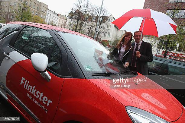 Rolf Luebke, Chairman of Deutsche Bahn Mobility Networks Logistics, which owns car-sharing provider Flinkster, poses with Elena Eybe, Flinkster's...