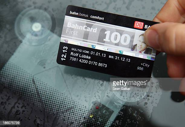 Rolf Luebke, Chairman of Deutsche Bahn Mobility Networks Logistics, which owns car-sharing provider Flinkster, demonstrates the use of a BahnCard 100...