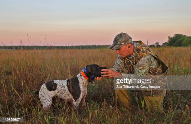 Rolf Moen of Brainerd receives a dove from his German shorthaired pointer Sally on the first day of the state's mourning dove season