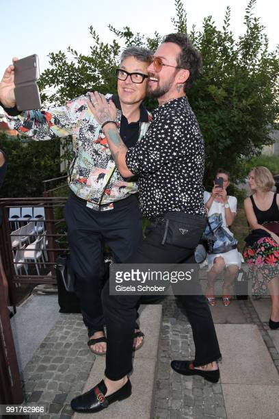 Rolf Scheider takes a selfie with Fashion designer Marcel Ostertag during the Marcel Ostertag show during the Berlin Fashion Week Spring/Summer 2019...