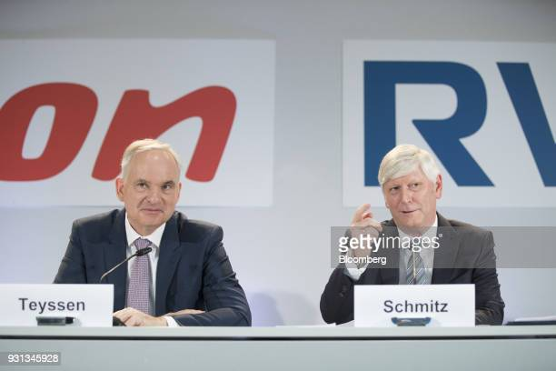 Rolf Schmitz chief executive officer of RWE AG right speaks as he sits beside Johannes Teyssen chief executive officer of EON SE during a news...