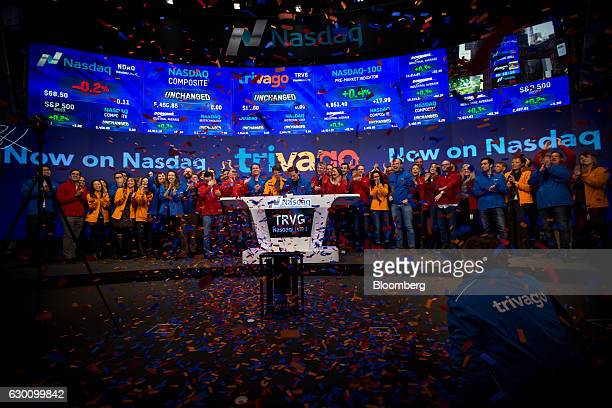 Rolf Schroemgens cofounder and chief executive officer of Trivago GmbH center celebrates with employees during the opening bell ceremony at the...
