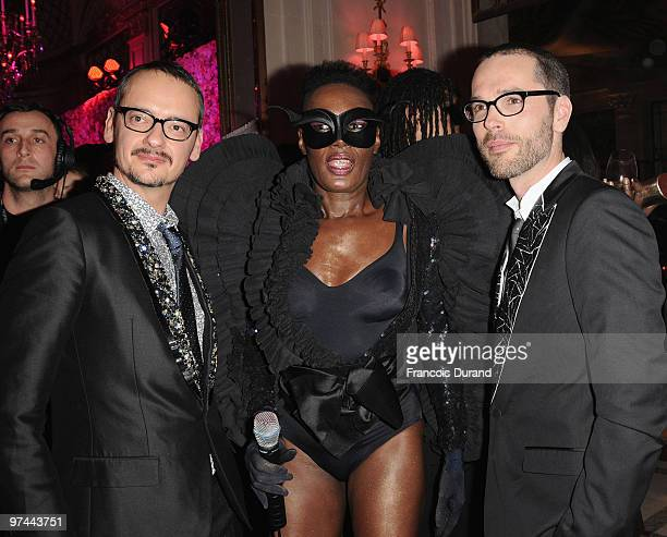 Rolf Snoeren, Grace Jones and Viktor Horsting attend the Victor & Rolf 'Flower Bomb' 5th Anniversary during Paris Fashion Week at Hotel Meurice on...