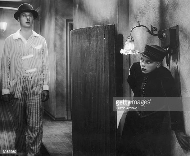 Rolf Wenkhaus as Emil watches Fritz Rasp sleepwalking in a scene from the famous German film 'Emil Und Die Detektive' adapted from the novel by Erich...