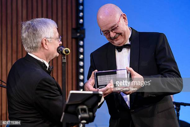 RolfDieter Krause receives the 'Preis der Bundespressekonferenz' award from Gregor Mayntz during the 65th Bundespresseball at Hotel Adlon on November...