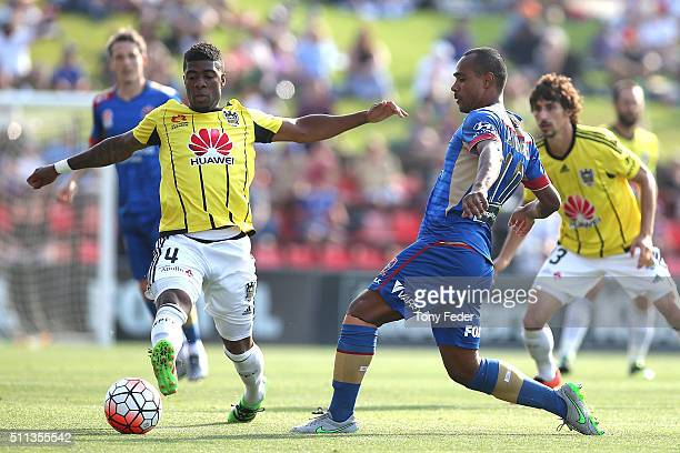 Rolieny Bonevacia of the Phoenix contests the ball with Leonardo Santiago of the Jets during the round 20 A-League match between the Newcastle Jets...