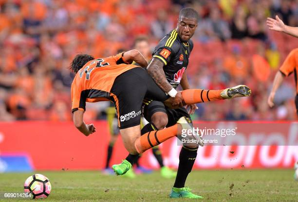 Rolieny Bonevacia of the Phoenix is penalised for this challenge on Thomas Broich of the Roar during the round 27 ALeague match between the Brisbane...