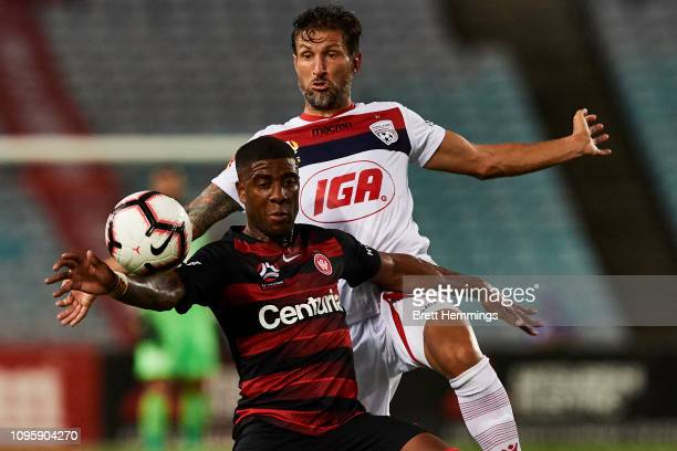 Rolieny Bonevacia of the Wanderers and Vince Lai of Adelaide contest the ball during the round 14 ALeague match between the Western Sydney Wanderers...
