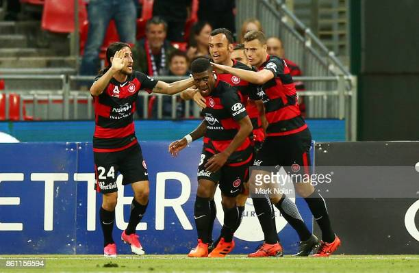 Rolieny Bonevacia of the Wanderers celebrates scoring a goal with team mates during the round two ALeague match between the Western Sydney Wanderers...