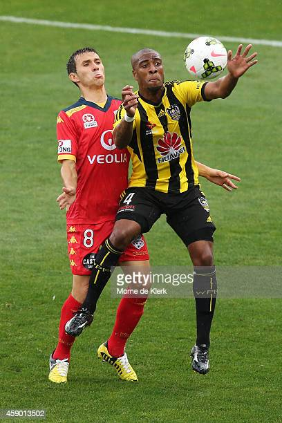 Rolieny Bonevacia of Wellington Phoenix competes with Isaias of Adelaide United during the round six ALeague match between Adelaide United and the...