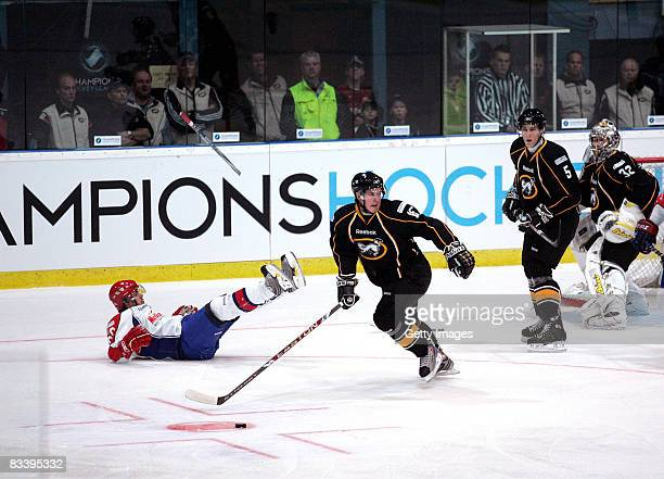 Rolinek Tomas of Metallurg Magnitogorsk fights for the puck with Karppinen Veikko of Kaerpaet Oulu during the IIHF Champions Hockey League match...