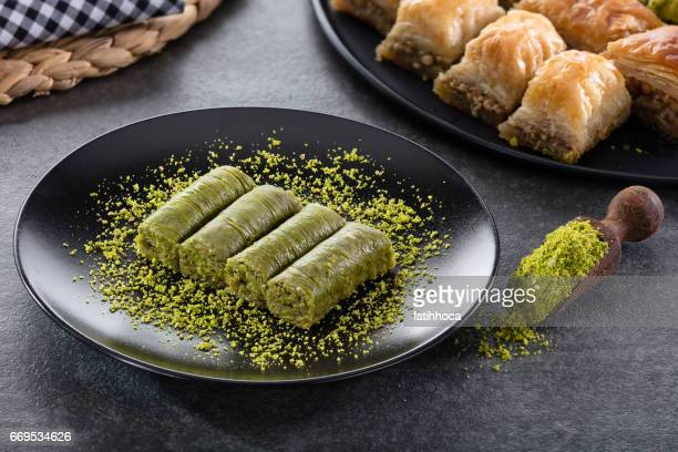 roll dessert with pistachio - persian culture stock photos and pictures