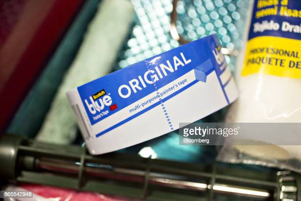A roll of 3M Co Scotch Blue brand painters tape is arranged for a photograph in Tiskilwa Illinois US on Monday Oct 23 2017 3M is scheduled to release...
