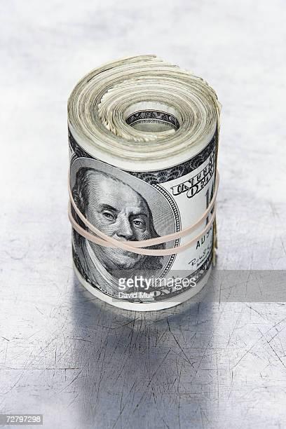 Roll of American dollar bills