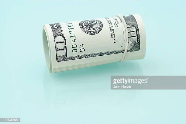 Roll of American dollars.