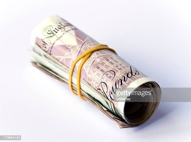 roll of bank notes - british pound note stock pictures, royalty-free photos & images