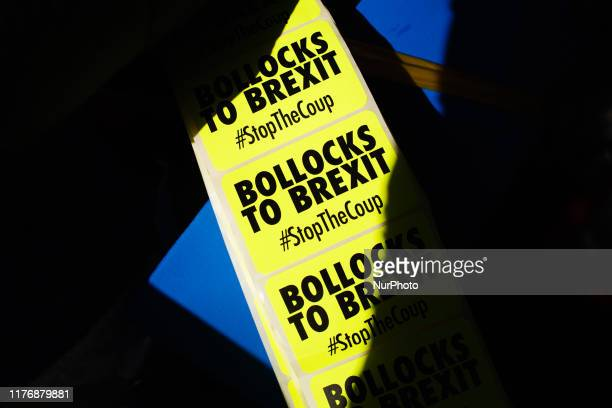 A roll of 'Bollocks To Brexit' stickers rest on an antiBrexit activist stall on Park Lane as people gather for the mass 'Together for the Final Say'...