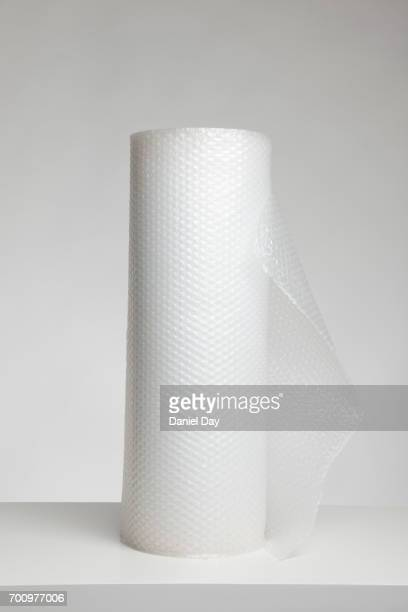 Roll of bubble wrap against light grey background