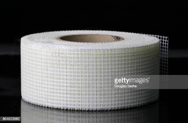 Roll of carpenters Drywall mesh tape on a black background