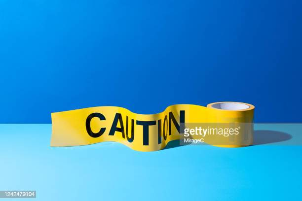 a roll of caution tape - cordon tape stock pictures, royalty-free photos & images