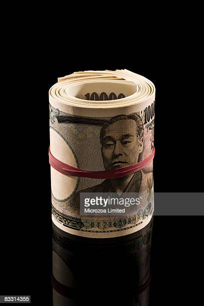 roll of chinese money yen - microzoa stockfoto's en -beelden