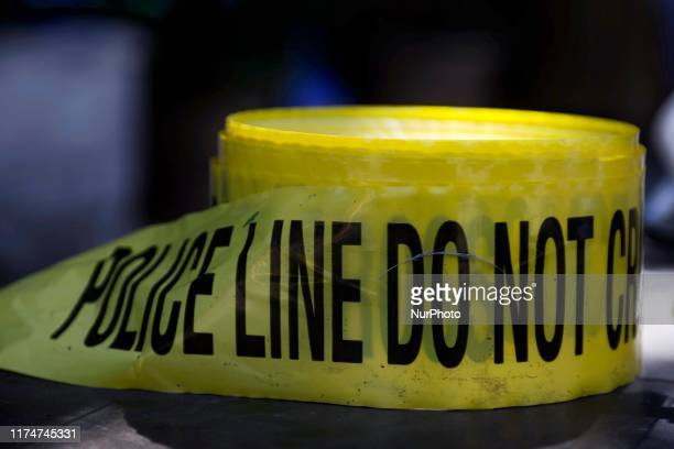 Roll of crime scene tape is unused as police officers interact with youth from the community during a block party on Sunday October 5 2019 at the...