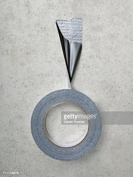Roll of duct tape stuck to concrete wall