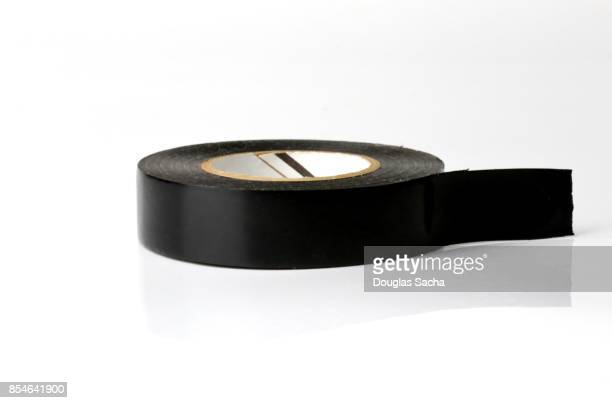 roll of electrical insulation tape - tape dispenser stock photos and pictures