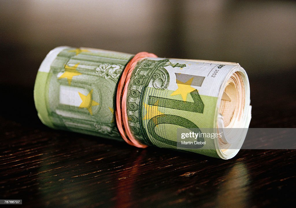 A roll of Euro banknotes : Stock Photo