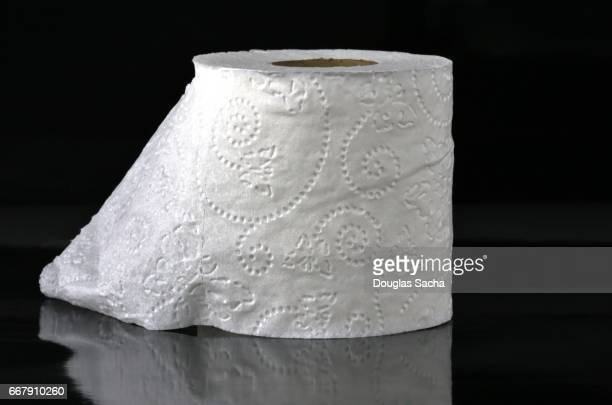 Roll of fancy Toilet Paper On a black Background