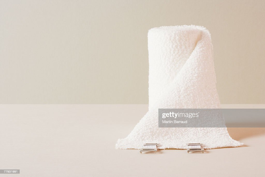 A roll of gauze sitting on a table : Stock Photo