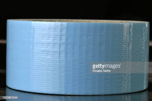 roll of heavy duty duct tape - tape dispenser stock photos and pictures
