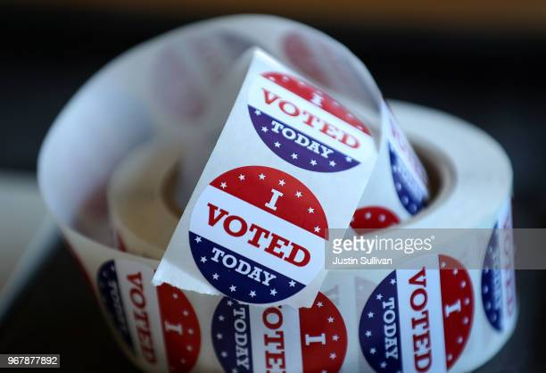 A roll of I Voted stickers sit on a table inside a polling station at a Ross Valley fire station on June 5 2018 in San Anselmo California California...