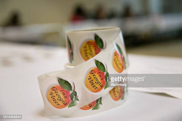 A roll of I'm a Georgia Voter stickers sit on a table during the Georgia primary runoff elections at a polling location in Atlanta Georgia US on...