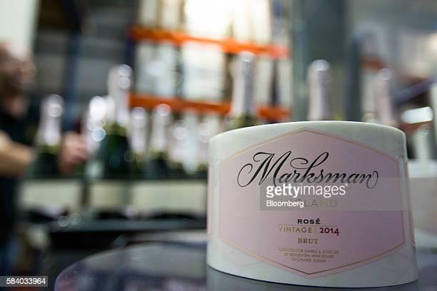 A roll of labels for bottles of Marksman sparking rose wine produced for Marks and Spencer Group Plc by Ridgeview Estate Winery sit near the...