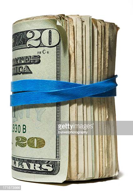 Roll of Money with blue rubber band,  white background